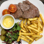 Grilled Rib Eye Steak with skin on fries